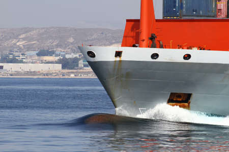 Container ship leaving the port of Alicante photo