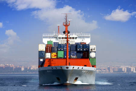 harbor: Container ship leaving the port of Alicante