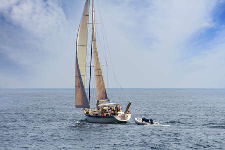 Sailing boat in open waters photo