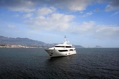 starboard: Private yacht anchored in Altea bay
