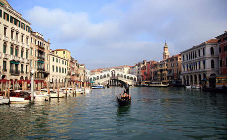 The famous Rialto bridge in the Grand Canal of Venice