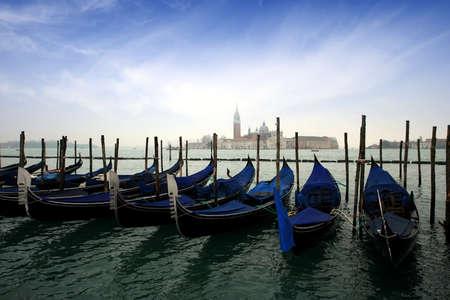 Gondolas docked in Venice photo