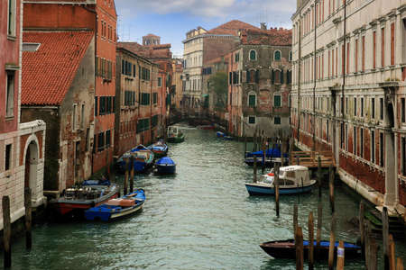 Lovely canals and bridges in the Sestieres of Venice photo