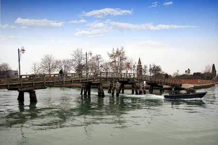 Bridge in the main canal of Burano island photo
