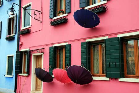 sestiere: Umbrellas in the colored houses of Burano island Stock Photo