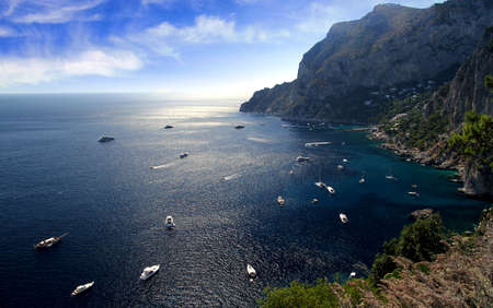 bluff: Yachts anchored in the south coast of Capri island Stock Photo