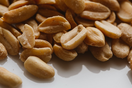 pine kernels: bunch of kernel peanuts on a light background closeup.