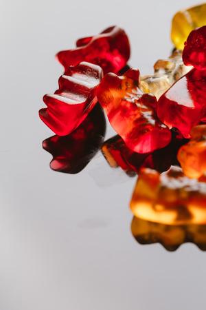 translucent red: gummi bears close-up on a dark background.