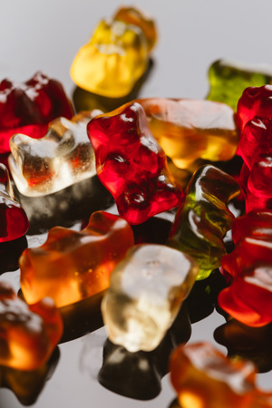 gummi bears close-up on a dark background.