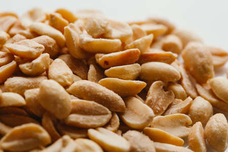 bunch of kernel peanuts on a light background closeup.