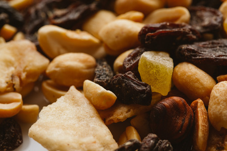 nibbles: dried fruits close-up on a light background. Stock Photo