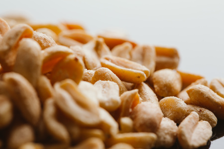 kernel: bunch of kernel peanuts on a blurred background close-up Stock Photo