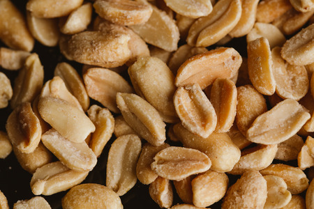bunch of kernel peanuts on a blurred background closeup. Stock Photo