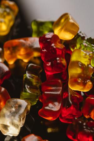 gummi bears close-up on a dark background.