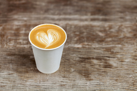 Cappuccino in a paper cup to go 版權商用圖片