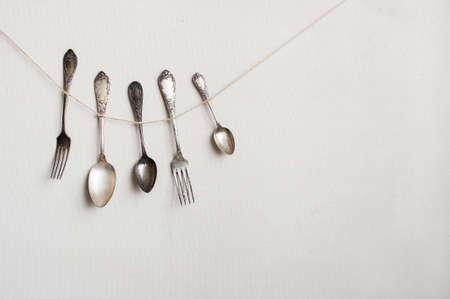 Silverware hangs on the string