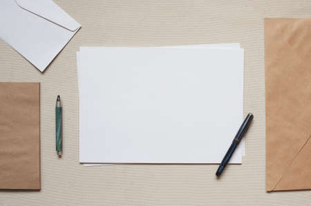 pen and paper: Empty envelopes and sheets of paper on the table