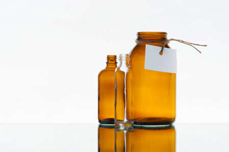 Empty various medicine bottles on the light background photo