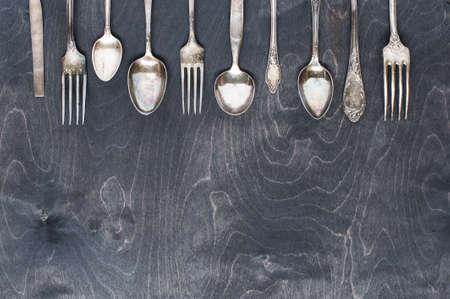 Silver cutlery on the dark wooden table Imagens - 41855435