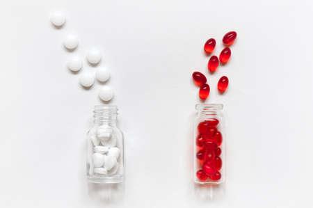 butch: Glass bottles and skattered pills on white background