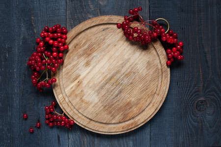 viburnum: Red viburnum on the old wooden table Stock Photo