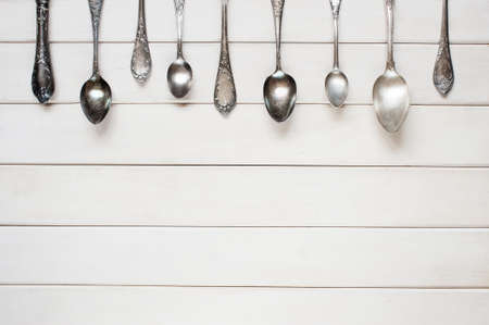 wooden spoon: Silver spoons on the white table