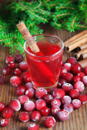 ?ranberry drink with cinnamon in the glass