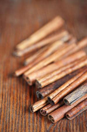 threadbare: Sticks of cinnamon on the old wooden table