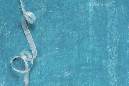 silver ribbon: Painted aged blue background with silver ribbon