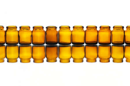 dropper: Empty medicine or cosmetic bottles on the white background with reflection