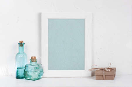 Empty Wooden White Frame, Vintage Blue Glass Bottles And Gift ...