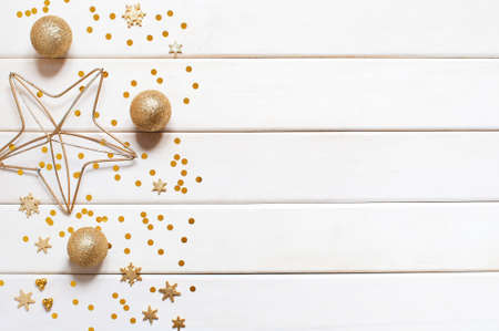 White wooden holiday background with golden decoration