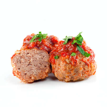 Cooked meatballs with tomato sauce on the white background Foto de archivo