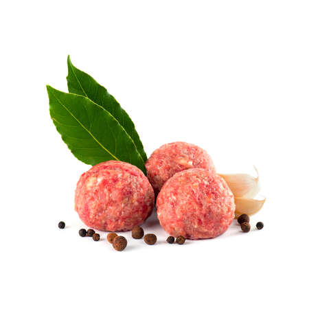 Composition with raw meatballs on the white background Stockfoto