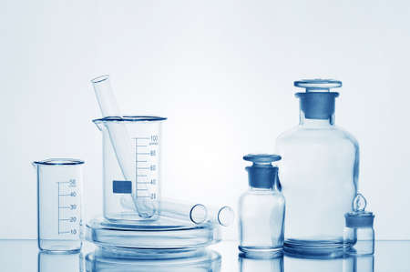 Various medicine bottles with transparent liquid on the mirror table Banco de Imagens