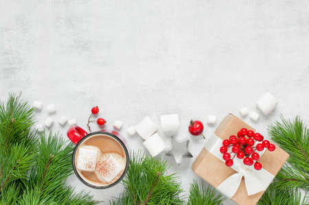 Festive Christmas background with mug of hot chocolate with marshmallow and gift box, copy space Stock Photo