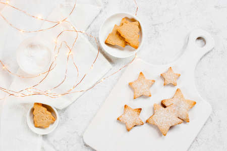 White winter composition with cookies - stars and firs