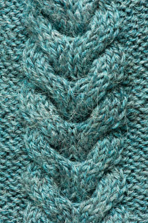 Texture of blue knitted fabric, copy space