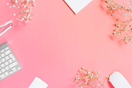Tender light pink background with notepad and keyboard, copy space Imagens