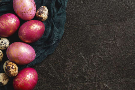 Background with painted pink Easter eggs with golden spots, copy space Imagens
