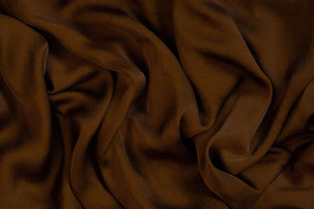 Texture of soft and shiny chocolate silk, top view Imagens