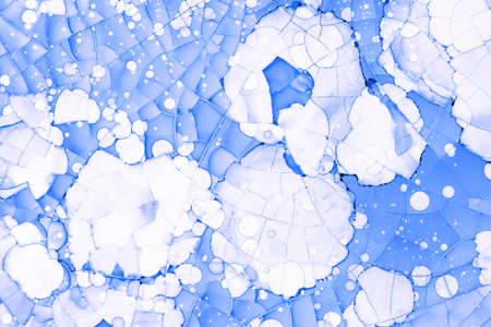 Abstract blue background with cracks and spots, textured surface