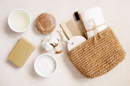 Organic body care and natural personal care products on the light beige table, top view composition