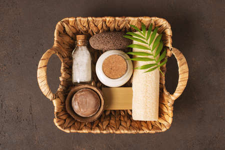 Organic body care products in the wicker basket, top view composition