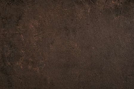 Dark brown painted textured surface with golden spots, top view, copy space background