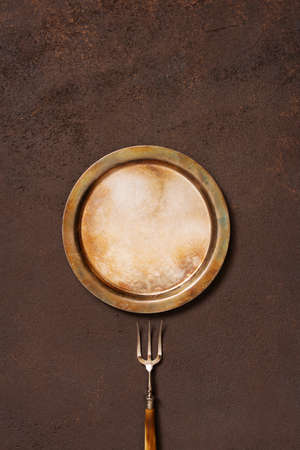 Background with vintage metal plate and fork, copy space, top view