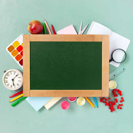 Bright background with school supplies and chalkboard, beginning of the school year 写真素材
