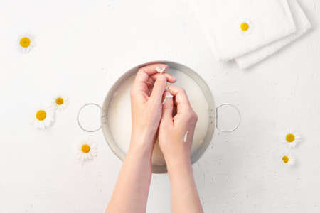 Hand skin care with natural cosmetics at home, home organic spa salon, top view