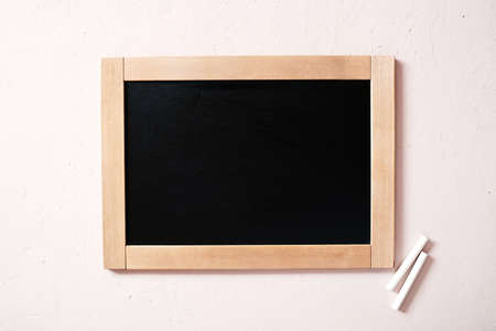 Background with chalkboard and chalk, overhead view, copy space