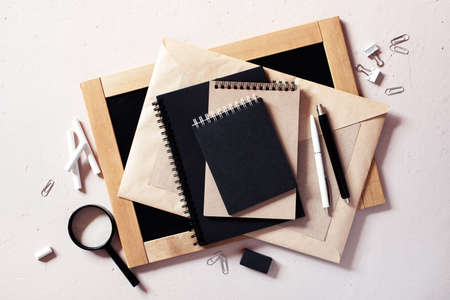 Education or office supplies on the textured beige table, overhead view